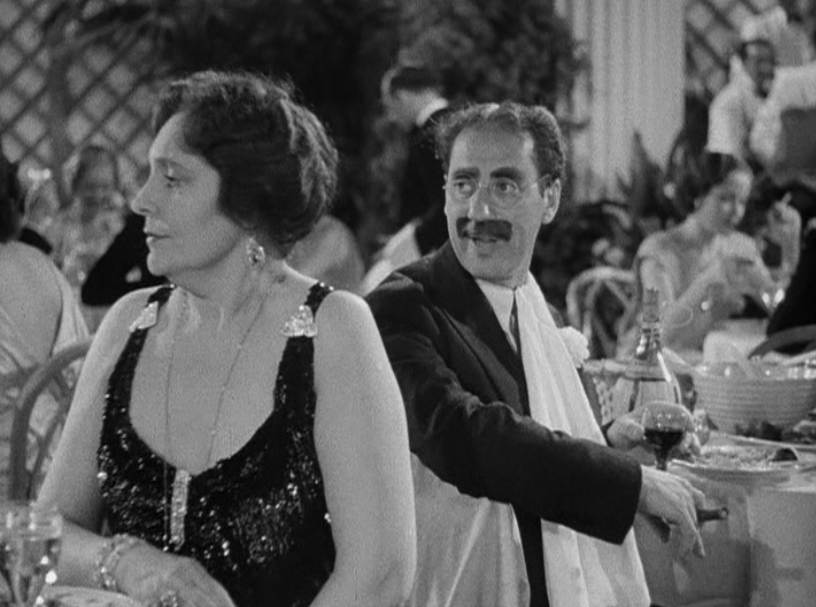 Margaret Dumont and Groucho Marx, perform the requisite amount of sparring.