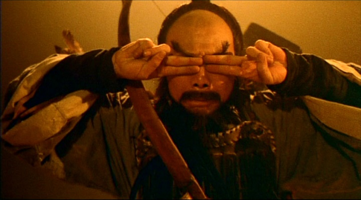 Wa Mu combats evil forces in A Chinese Ghost Story (1987). Later he raps.