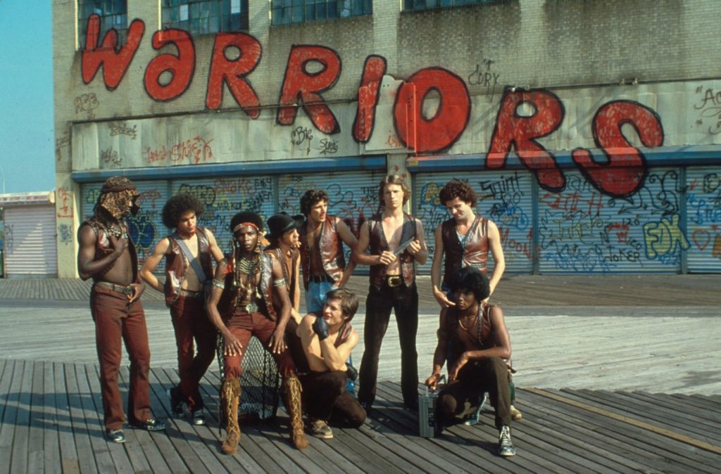 Walter Hill's The Warriors. Imagine them, I suppose, in banana yellow leather vests.
