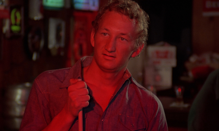 Robert Englund plays one of those trashy weirdos tucked away in Tobe Hooper's freak show attraction.
