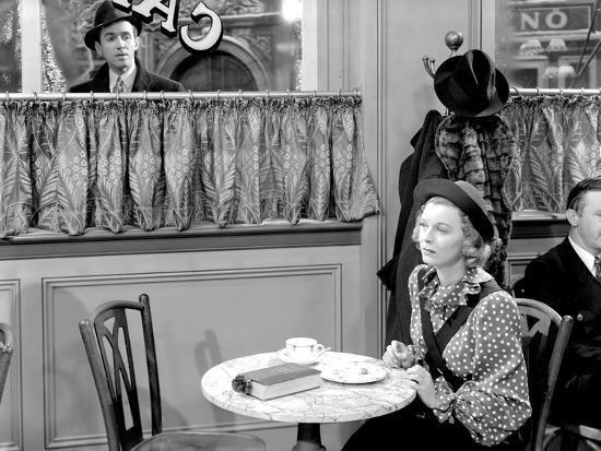 Jimmy Stewart peers into the window at Margaret Sullavan in The Shop Around the Corner
